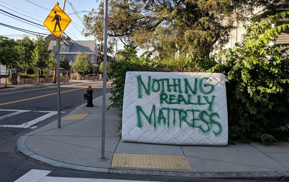 Mattress painted to read: Nothing Really Mattress