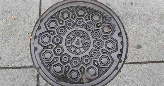 New England Telephone and Telegraph Co. manhole cover on Essex Street in Chinatown