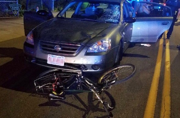 Car in Everett with bicycle wedged in front