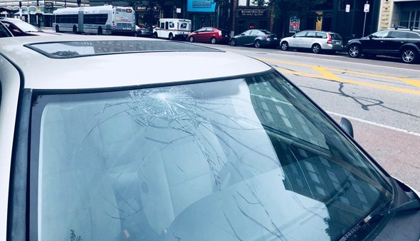 Busted windshield on Washington Street in the South End
