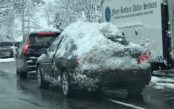 Masshole driver can't be bothered with removing snow