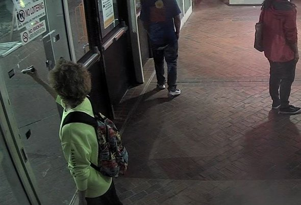 Man scribbling on door at Forest Hills MBTA station