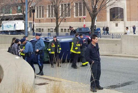 Car flip at I-93 entrance in downtown Boston