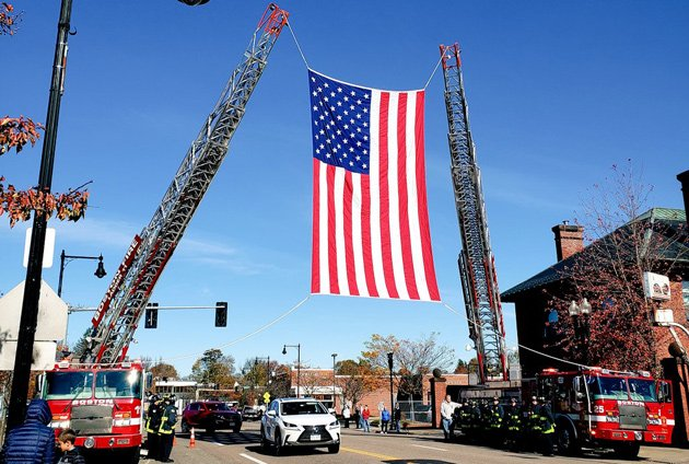 Big flag draped over Centre Street in West Roxbury to honor World War II flyer