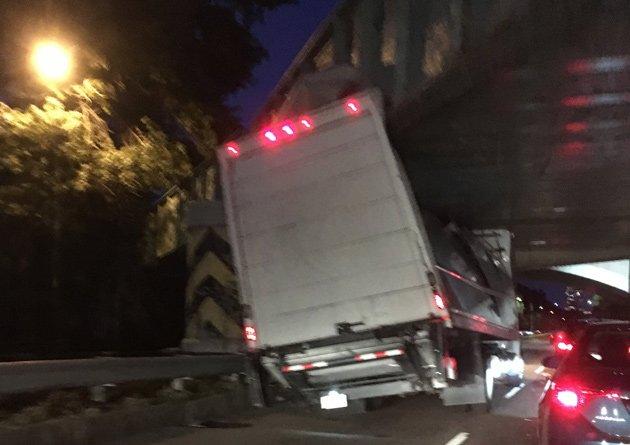 Bridge demolishs truck