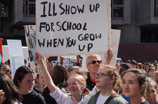 Sign: I'll show up for school when you grow up