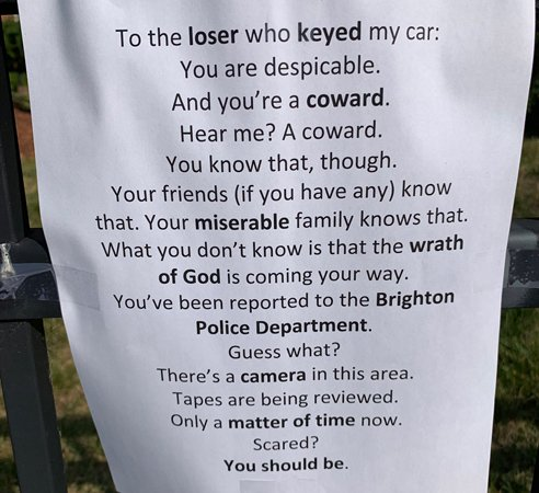 Sign warning whoever keyed a car to watch his back; owner has video