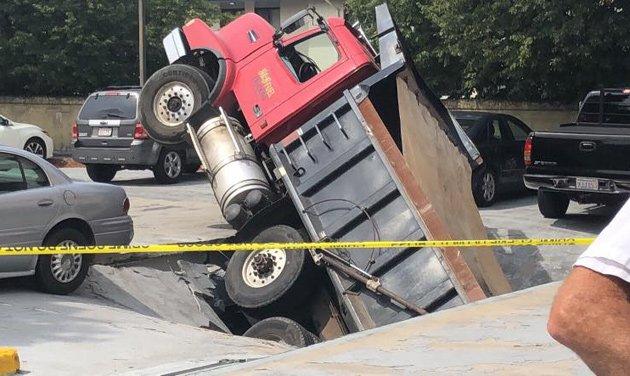 Dump truck falls through Quincy garage