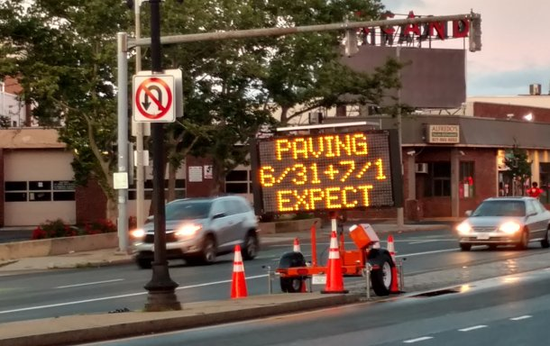 Sign advising of paving on June 31 in Allston