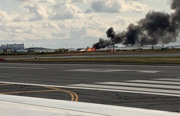 Flaming plane at Logan Airport