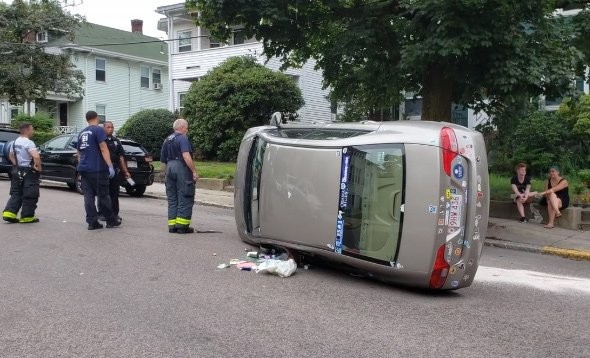 Flipped car in Jamaica Plain