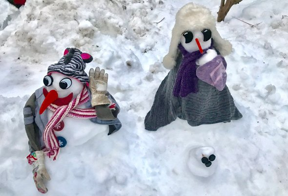 Snowman and snowwoman with weird eyes in Roslindale