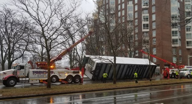Truck load tipped over by the wind on Land Boulevard