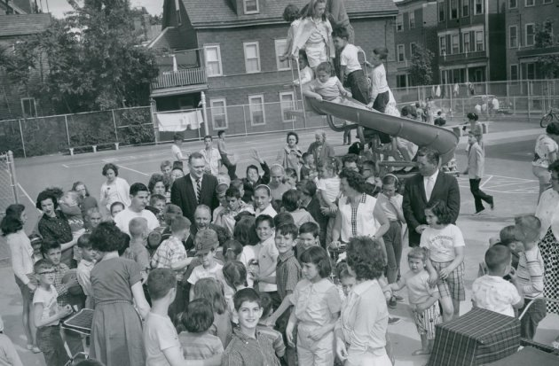 A lot of kids in black and white in old Boston