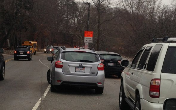 Car parked badly at Jamaica Pond