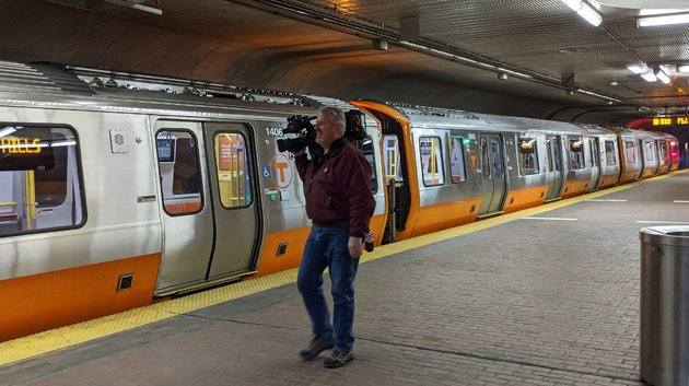New train, with bonus cameraman, at Forest Hills this morning