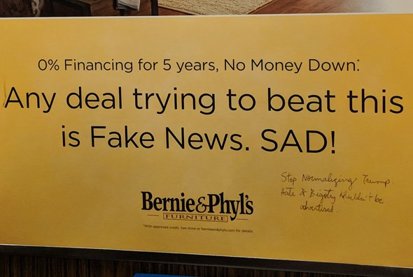 Bernie and Phylls ad that clals other deals Fake News is met with pen scrawl asking them to stop normalizing Trump