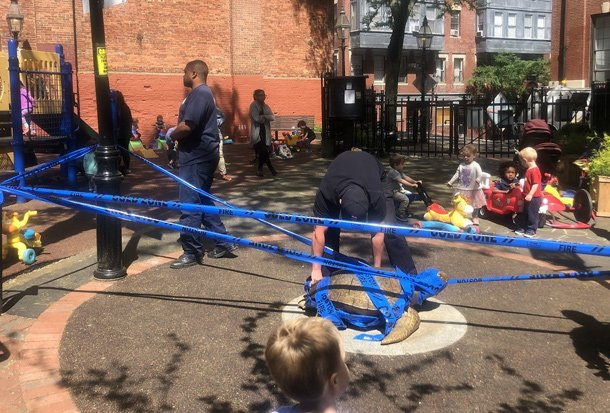 City workers taping off hot turtle at Myrtle Street playground