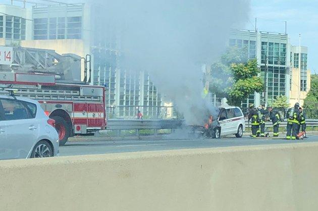 Minivan on fire on the Massachusetts Turnpike
