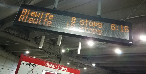 Quincy Adams sign says train is 18 stops away