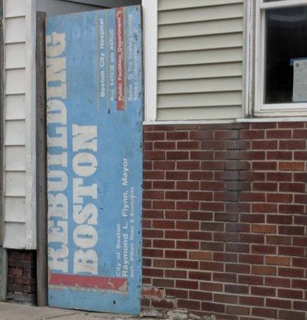 Sign advertising work at Boston City Hospital, Raymond L. Flynn, mayor