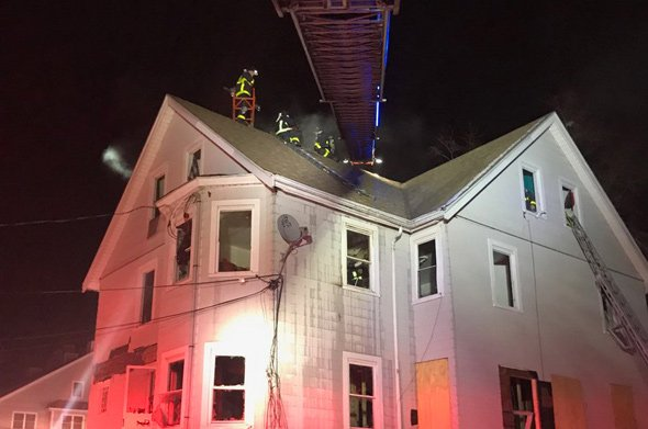 Firefighters at 19 Harrison St. in Roslindale