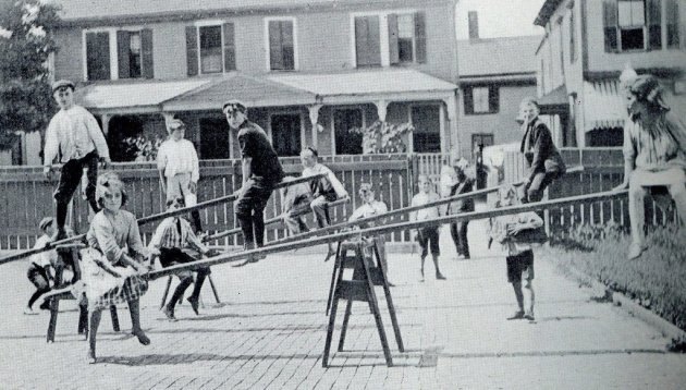 Kids on seesaws in old Boston