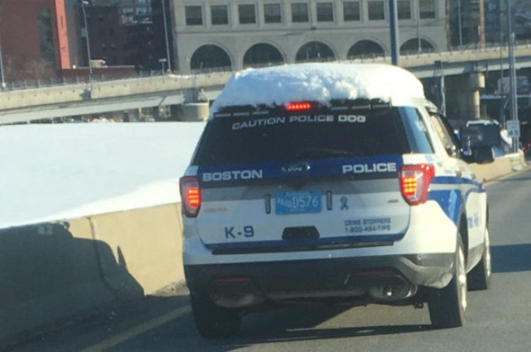 Snow-covered Boston Police cruiser on the Southeast Expressway
