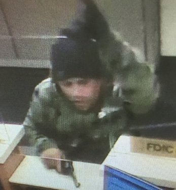 Wanted for Somerville bank robbery, shooting at officer