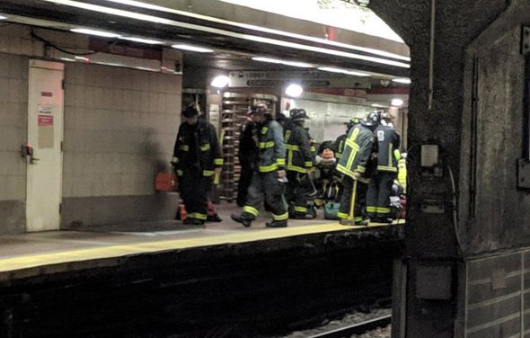 Firefighters getting ready to go on tracks