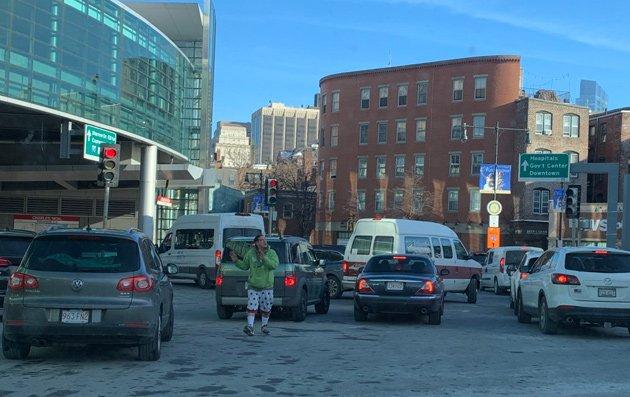 Guy directing traffic at Charles Circle