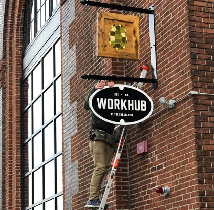 Workhub sign going up