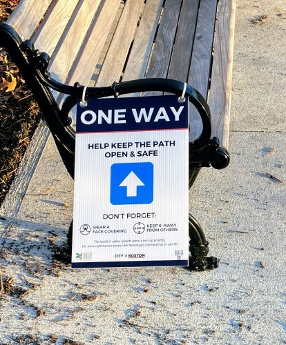 """one way"" pedestrian sign on bench at Jamaica Pond"