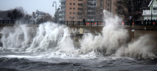 Waves slam into Lynn seawall