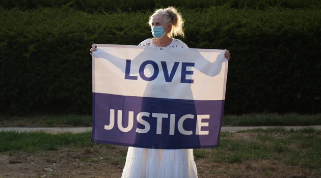 Woman with Love and Justice banner