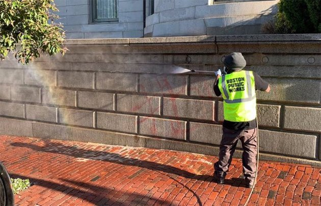 Public Works employee removing graffiti