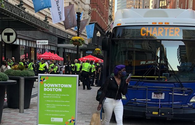 Bus bearing police officers in Downtown Crossing