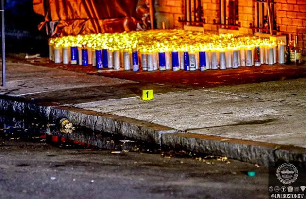 Evidence marker and candles on Circuit Street