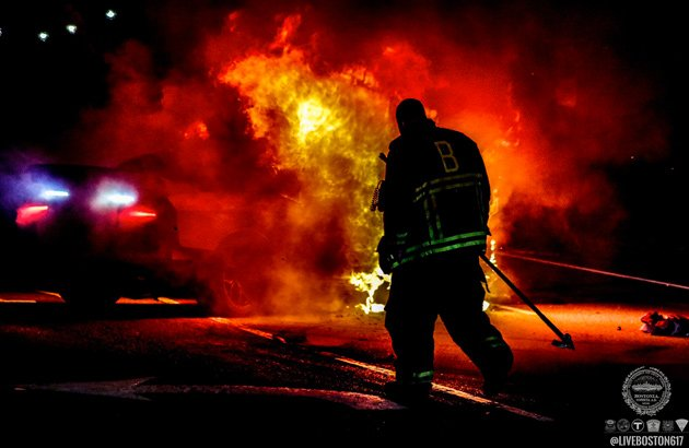 Firefighter at car fire