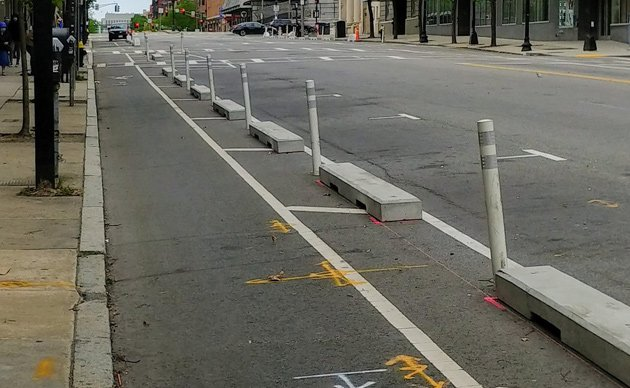 New concrete barriers along bike lane on Massachusetts Avenue