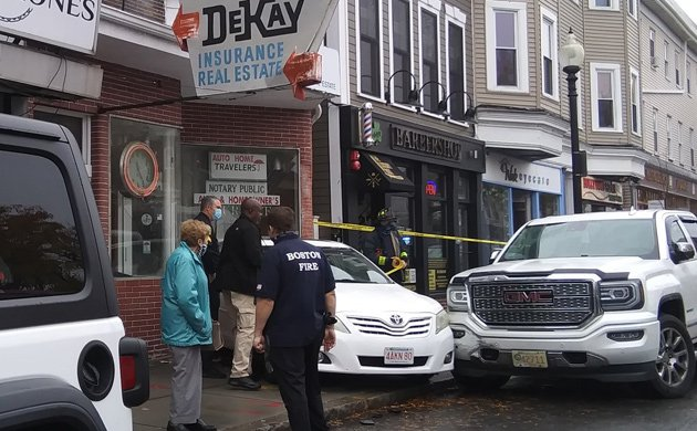 Car into East Broadway insurance agency