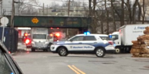 Truck wedged under MBTA bridge in Dorchester