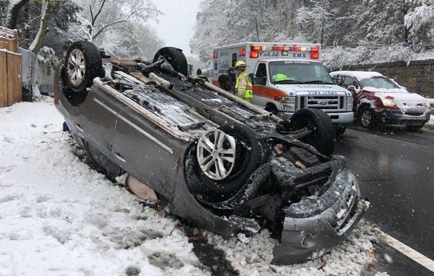 Overturned car on Rte. 9 in Wellesley