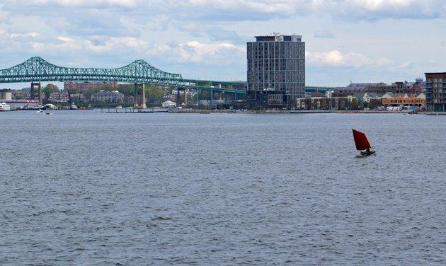 Lone sailboat on Boston Harbor waters