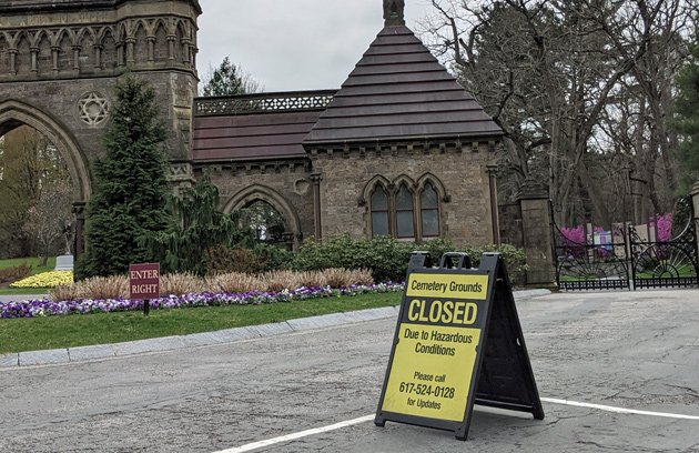 Sign saying Forest Hills Cemetery is now closed