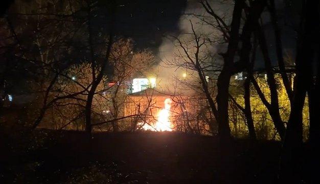 Flaming trash behind Party City