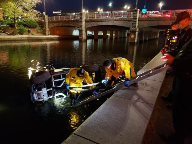 Golf cart being retrieved from Lechmere Canal