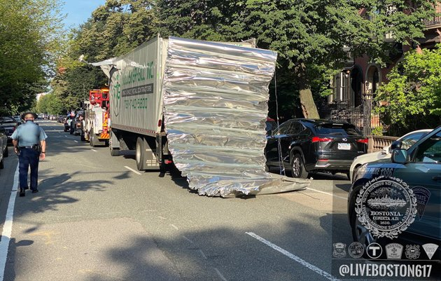 Box truck with peeled-back roof after hitting a bridge on Storrow Drive