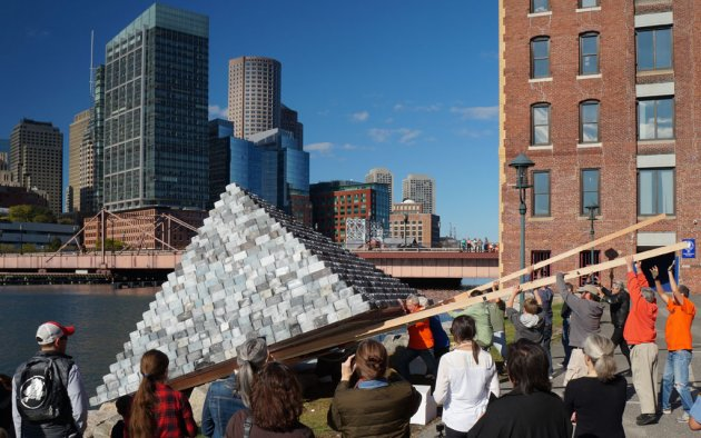 Pyramid sculpture being launched into Fort Point Channel in Boston