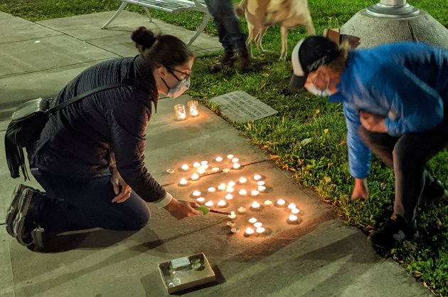 Lighting candles in Ginsburg's honor in Adams Park